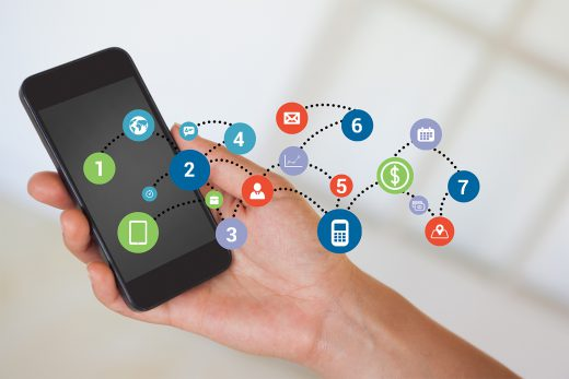 Composite image of hand holding smartphone with smartphone icons and numbers